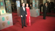 Rafe Spall Elize Du Toit at EE British Academy Film Awards 2013 Red Carpet Arrivals at The Royal Opera House on February 10 2013 in London England
