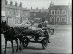 Rag and bone man travels along street on horse and cart