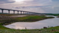 Rail bridge 'Pa Sak Jolasid Dam' on twilight time lapse