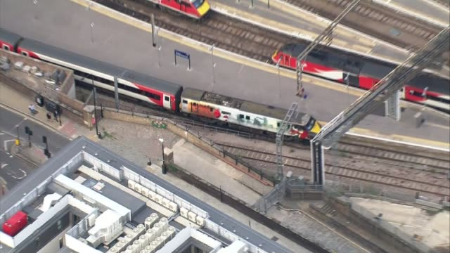 Rail fares to rise by 36 per cent in 2018 ENGLAND London Train on platform at King's Cross ZOOM IN AIR VIEW Derailed train at Waterloo
