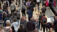 Rail fares to rise by 36 per cent in 2018 Waterloo Station INT High angle shots of rail passengers along busy platform Close shot of electronic...