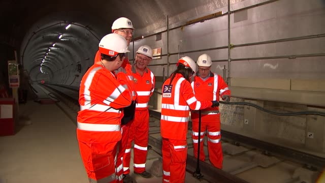 Final piece of Crossrail track laid Chris Grayling interview ENGLAND London INT Crossrail tracks and tunnels / Chris Grayling Val Shawcross and...