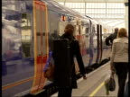 South West Trains begins new tenyear franchise Trains and passengers at station Passengers boarding train / train leaving station / South West Trains...