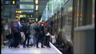 St Pancras railway station Travellers onto Eurostar train with suitcases