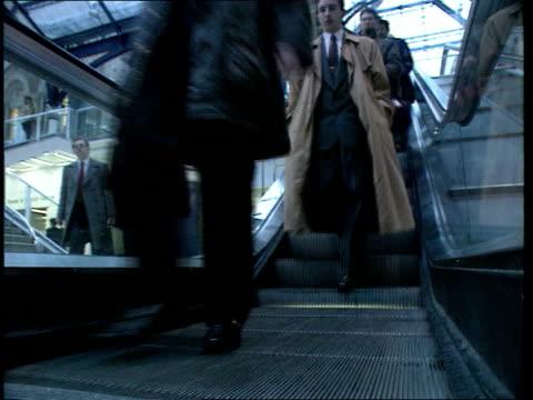 Rail strike preview ENGLAND London Liverpool Street Station Cape i/c SOF LAMS Passengers through gates towards LAMS Passengers down escalators...