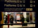 Failure to meet timetable deadline ITN ENGLAND Unidentified Commuters past along station platform GVs Passengers thru ticket barriers MS Virgin...