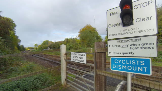 Railway pedestrian level crossing with an East Midlands Trains