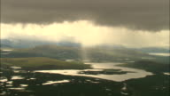 Rain clouds hover over the countryside near the Parve Fault in Sweden. Available in HD.