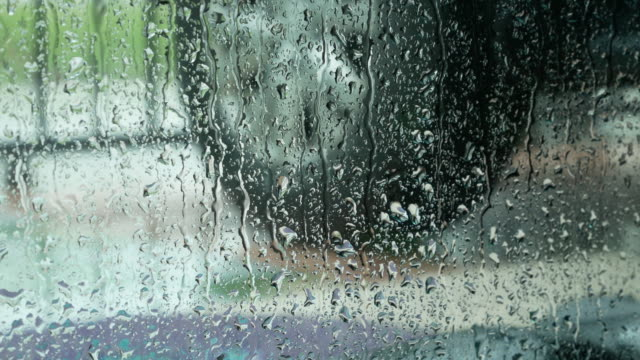 Rain drop at the window in rainy day