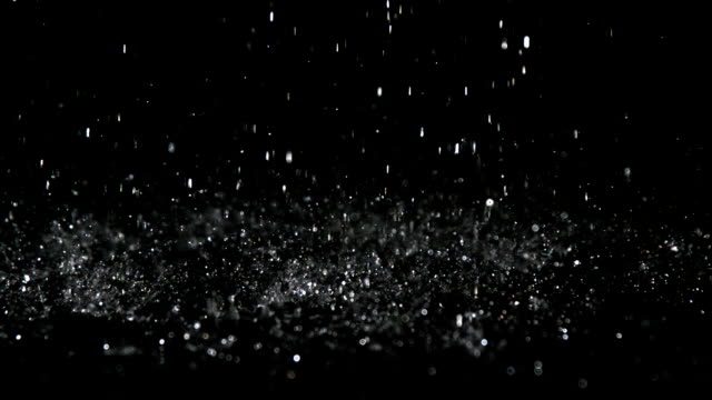 Rain falling on black surface