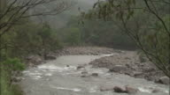 Rain falls on river, Chopta, India Available in HD.