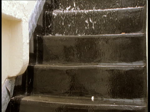 Rain water splashing down flight of steps