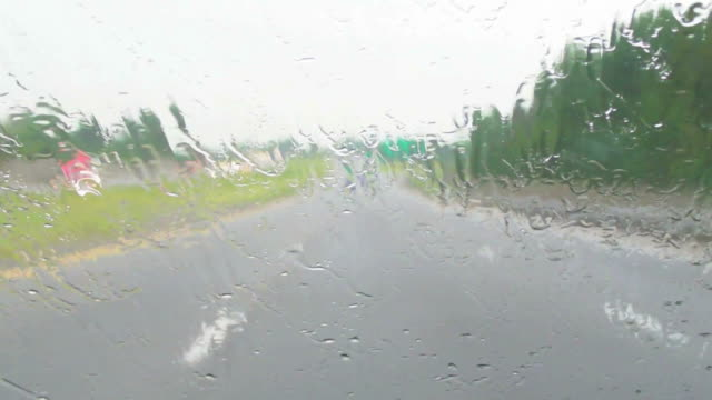 Rain, windshield, highway, traffic.