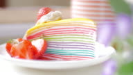 Rainbow multi colored crepe cake with strawberry