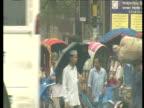 Rainy streets crowded with traffic and people Dhaka Bangladesh