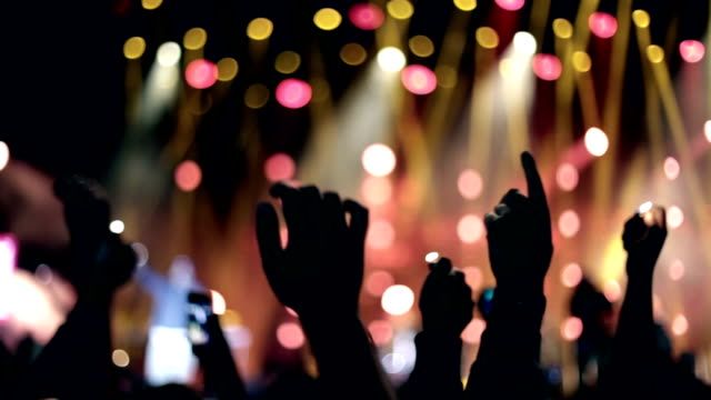 Raised hands with smartphones and lighters, Concert Hip hop