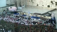 Raising the Israeli flag during the commemoration of the 50th Anniversary of the Six Day War