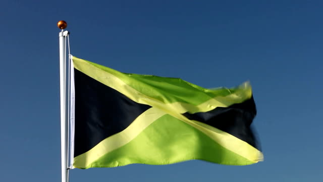 Raising the Jamaican national flag