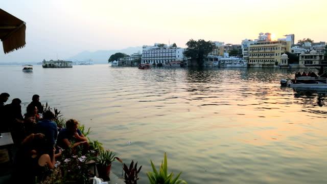 Rajasthan Udaipur Lake Pichola India people sunset