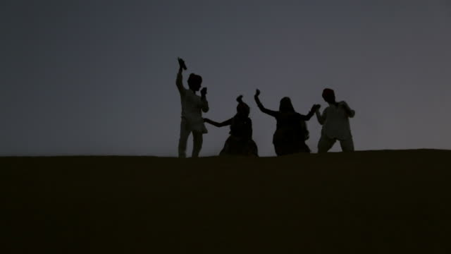 Rajasthani people dancing on desert, Sam Desert, Jaisalmer, Rajasthan, India