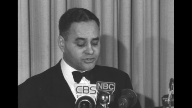 VS Ralph Bunche speaks at CBS NBC other microphones after receiving the Four Freedoms Award 'I have learned well enough how to use freedom our...