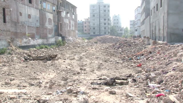 Rana Plaza families still waiting for compensation GVs rubble of building site where Rana Plaza stood before the building collapsed in April 2013...