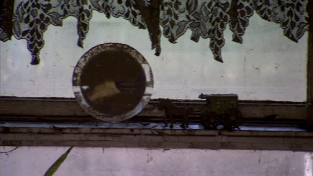 Random household items rest atop a filthy window sill after a flood in Cedar Rapids, Iowa.