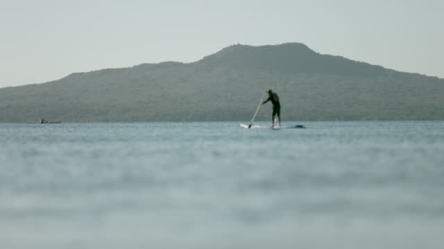 Rangitoto with stand up paddle-boarder