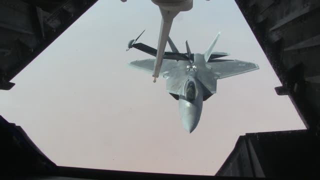 F22 Raptor Air Refueling with cockpit close up over Al Dhafra Air Base United Arab Emirates