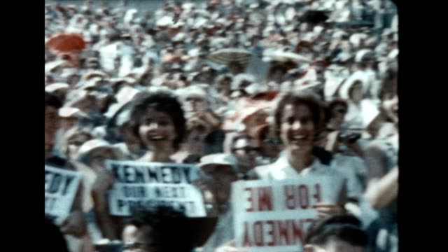 Rare color footage of the 1960 Democratic National Convention at the Los Angeles Coliseum / people in stands holding up signs 'KENNEDY OUR NEXT...