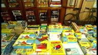 Rare Dinky cars Various shots of boxes of 'Meccano Dinky Toys' laid out on table/ Dinky Toys Dinky Cars displayed in galss cabinet in shop / Meccano...