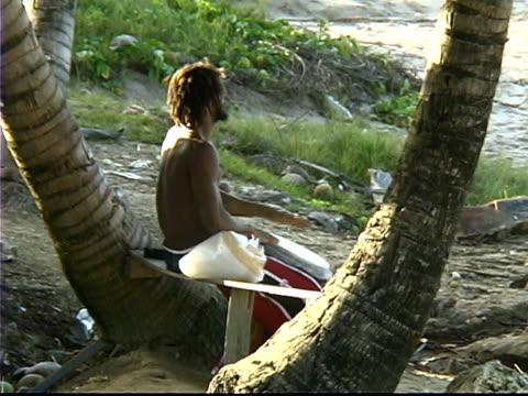 Rasta Drummer on Beach