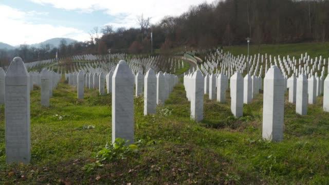 Ratko Mladic appears before ICC on charges of genocide BOSNIA AND HERZEGOVINA Republika Srpsk Srebrenica EXT PAN gravestones at Srebrenica Genocide...