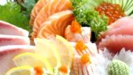 Raw and fresh mixed sashimi with salmon , tuna , hamaji and other