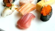 Raw and fresh nigiri sushi set in white plate