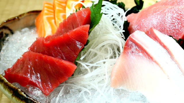 Raw and fresh salmon tuna and other sashimi fish meat