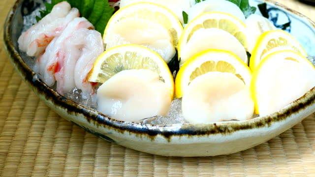 Raw and fresh sashimi set with hotate oyster and prawn or shrimp