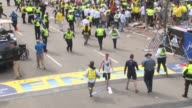 / raw footage of the chaos and confusion following the Boston Marathon bombing