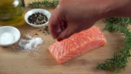Raw Salmon Filet Seasoned with Sea Salt and Crushed Pepper