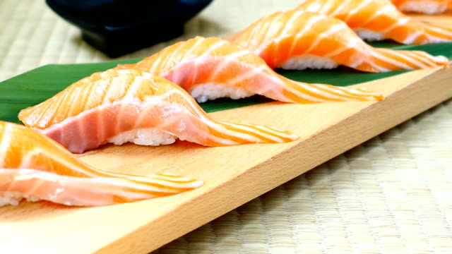 Raw with fresh salmon fish meat sushi on wooden tray - Japanese food style