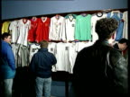 Momentoes to be auctioned CF SCOTLAND Glasgow MS Display of Ray Kennedy's Jerseys on wall as people examining PAN LR CS Liverpool badge on shirt CS...