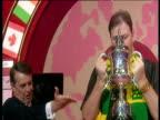 Raymond Barneveld lifts trophy kisses trophy raises aloft 2003 Embassy World Darts Championships Lakeside Frimley Green