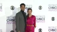 Raza Jaffrey and Lara Pulver at the People's Choice Awards 2016 at Nokia Plaza LA LIVE on January 6 2016 in Los Angeles California