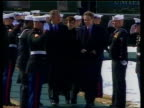 Reaction LIB USA Maryland Camp David EXT SIDE Naval officers along holding Union Jack and USA flags PAN BV US President George WBush along to greet...