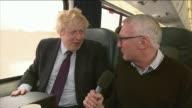 Reaction to Boris Johnson appointment as Foreign Secretary T10021547 / INT Johnson chatting to commuter on subway platform Boris Johnson interview on...