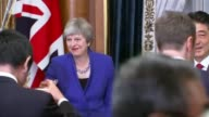 Reaction to Theresa May comments on leading the Conservative Party into the next general election ****FLASH Tokyo INT May Abe and others drinking...