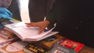 Readers have a look at books at an Islamic book fair in front of Baitul Mukarram Mosque in the capital yesterday The monthlong fair organised by...
