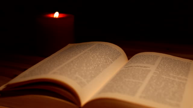 Reading Book in Candle Light