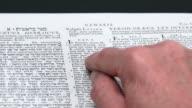 HD Reading Genesis 1 Close-up (Rack Focus) (4:2:2)