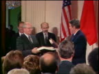 Reagan Gorbachev shake hands after signing Intermediate Range Nuclear Forces Treaty